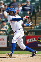 Round Rock Express shortstop Jurickson Profar #10 follows through on his swing against the New Orleans Zephyrs in the Pacific Coast League baseball game on April 21, 2013 at the Dell Diamond in Round Rock, Texas. Round Rock defeated New Orleans 7-1. (Andrew Woolley/Four Seam Images).