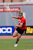 Laura Merrifield (9) of Maryland brings the ball into the attacking half during the ACC women's lacrosse tournament finals in College Park, MD.  Maryland defeated North Carolina, 10-5.