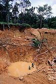 Maria Bonita, Xingu, Brazil. Garimpo illegal gold mine with garimpeiros waist deep in muddy water. Para State.