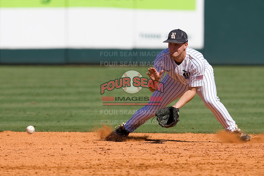 Rice Owls shortstop Derek Hamilton #4 fields a ground ball against the Memphis TIgers in NCAA Conference USA baseball on May 14, 2011 at Reckling Park in Houston, Texas. (Photo by Andrew Woolley / Four Seam Images)