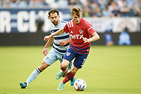 KANSAS CITY, KS - JULY 31: Szabolcs Schon #11 FC Dallas with the ball during a game between FC Dallas and Sporting Kansas City at Children's Mercy Park on July 31, 2021 in Kansas City, Kansas.