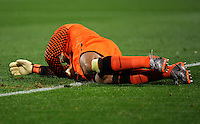 USA goalkeeper Tim Howard lays on the ground after being kicked in the ribs. USA tied England 1-1 in the 2010 FIFA World Cup at Royal Bafokeng Stadium in Rustenburg, South Africa on June 12, 2010.