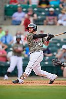Arkansas Travelers designated hitter Tyler Marlette (30) follows through on a swing during a game against the Frisco RoughRiders on May 28, 2017 at Dickey-Stephens Park in Little Rock, Arkansas.  Arkansas defeated Frisco 17-3.  (Mike Janes/Four Seam Images)