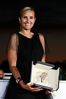 CANNES, FRANCE - JULY 17: Julia Ducournau poses with the Palme d'Or 'Best Movie Award' for 'Titane' during the 74th annual Cannes Film Festival on July 17, 2021 in Cannes, France. <br /> CAP/GOL<br /> ©GOL/Capital Pictures