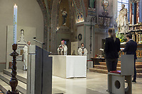 """Switzerland. Canton Ticino. Lugano. Easter in Cattedrale di San Lorenzo. The bishop Valerio Lazzeri celebrates the Sunday mass in an empty cathedral. The believers could not attend the religious service due to the coronavirus. Valerio Lazzeri (born 22 July 1963) is a Swiss Roman Catholic bishop. Ordained to the priesthood on 2 September 1989, Lazzeri was named bishop of the Roman Catholic Diocese of Lugano, Switzerland on 4 November 2013. Easter, also called Pascha or Resurrection Sunday, is a festival and holiday commemorating the resurrection of Jesus from the dead, described in the New Testament as having occurred on the third day after his burial following his crucifixion by the Romans. The Diocese of Lugano is a branch of the Catholic Church immediately subject to the Holy See.  Due to the spread of the coronavirus (also called Covid-19), the Federal Council has categorised the situation in the country as """"extraordinary"""". It has issued a recommendation to all citizens to stay at home, especially the sick and the elderly. From March 16 the government ramped up its response to the widening pandemic, ordering the closure of religious services. 12.04.2020  © 2020 Didier Ruef"""