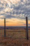 A beautiful sunset can be seen over the Kansas prairie.