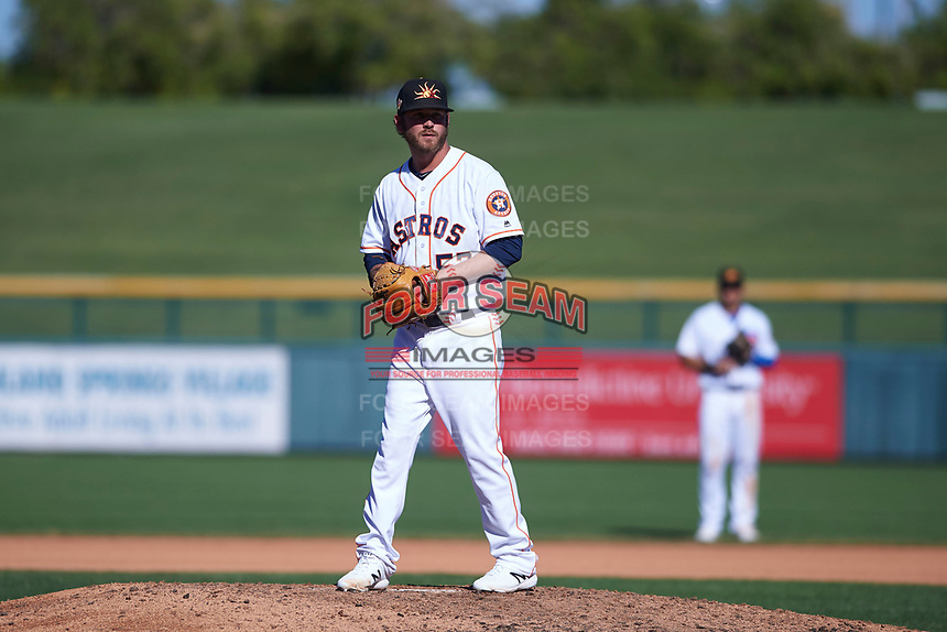 Mesa Solar Sox relief pitcher Brendan McCurry (53), of the Houston Astros organization, prepares to deliver a pitch to the plate during an Arizona Fall League game against the Peoria Javelinas on October 25, 2017 at Sloan Park in Mesa, Arizona. The Solar Sox defeated the Javelinas 6-3. (Zachary Lucy/Four Seam Images)
