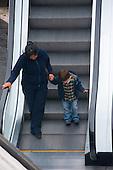 Lima, Peru. Miraflores district, Larcomar Mall.  Mother and son (young child, Peruvian) go down escalator together. No MR. ID: AL-peru.
