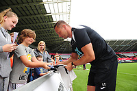 Swansea City's Club Ambassador Lee Trundle with fans during the Swansea City Training at The Liberty Stadium, Swansea, Wales, UK. Tuesday 07 August 2018