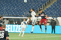 FOXBOROUGH, MA - NOVEMBER 1: Gelmin Rivas #20 of DC United and Brandon Bye #15 of New England Revolution compete for a high ball during a game between D.C. United and New England Revolution at Gillette Stadium on November 1, 2020 in Foxborough, Massachusetts.