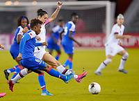 HOUSTON, TX - JANUARY 28: Carli Loyd #10 of the United States battles Melchie Dumonay #6 of Haiti for a ball during a game between Haiti and USWNT at BBVA Stadium on January 28, 2020 in Houston, Texas.