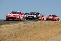Jun. 21, 2009; Sonoma, CA, USA; NASCAR Sprint Cup Series driver Tony Stewart (14) leads Brian Vickers (83) during the SaveMart 350 at Infineon Raceway. Mandatory Credit: Mark J. Rebilas-