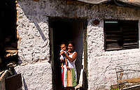 Havana capitol city of Cuba with local people mother and children in their Lawton neighborhood in the city