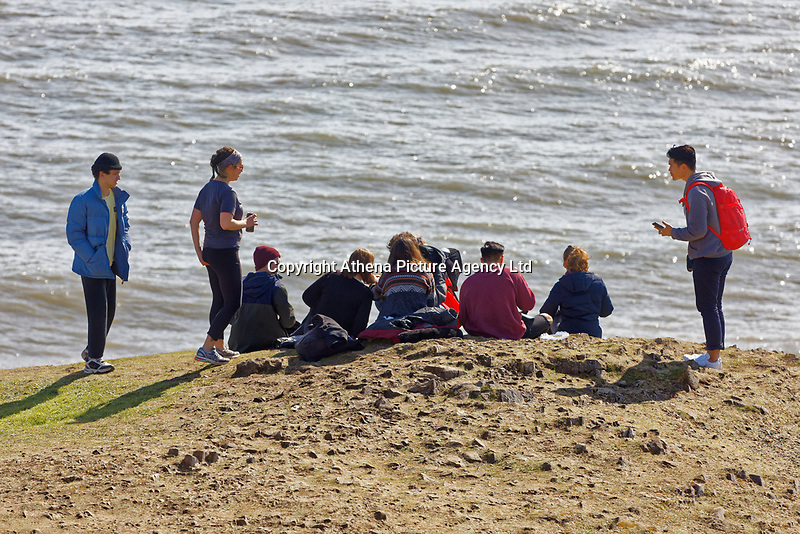 Pictured: A group of walkers on the coastal path by Langland Bay near Swansea, Wales, UK. Sunday 22 March 2020<br /> Re: Covid-19 Coronavirus pandemic, UK.