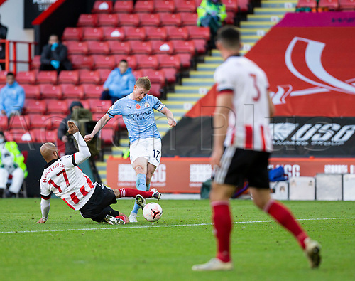 31st October 2020; Bramall Lane, Sheffield, Yorkshire, England; English Premier League Football, Sheffield United versus Manchester City; Kevin De Bruyne of Manchester City takes a shot at goal as David McGoldrick of Sheffield United slides in for a tackle