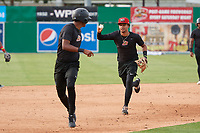 Batavia Muckdogs infielder Gerardo Nunez (right) chases down Brayan Hernandez in a run down drill during practice on June 12, 2019 at Dwyer Stadium in Batavia, New York.  (Mike Janes/Four Seam Images)