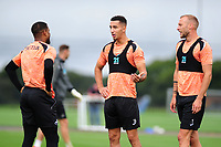 Luciano Narsingh speaks with Courtney Baker-Richardson of Swansea City during the Swansea City Training Session at The Fairwood Training Ground, Wales, UK. Tuesday 11th September 2018