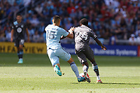 ST. PAUL, MN - AUGUST 21: Roger Espinoza #15 of Sporting Kansas City and Justin McMaster #24 of Minnesota United FC battle for the ball during a game between Sporting Kansas City and Minnesota United FC at Allianz Field on August 21, 2021 in St. Paul, Minnesota.