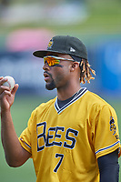 Jo Adell (7) of the Salt Lake Bees warms up in the outfield before the game against the Tacoma Rainiers at Smith's Ballpark on May 16, 2021 in Salt Lake City, Utah. The Bees defeated the Rainiers 8-7. (Stephen Smith/Four Seam Images)