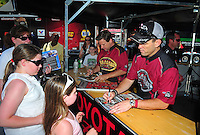 Jun. 17, 2011; Bristol, TN, USA: NHRA top fuel dragster driver Larry Dixon (right) and teammate Del Worsham sign autographs for fans during qualifying for the Thunder Valley Nationals at Bristol Dragway. Mandatory Credit: Mark J. Rebilas-