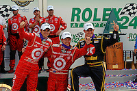 (L to R): Dan Wheldon, Scott Dixon and Casey Mears in Victory Lane.