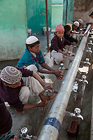 Madrasa Students Performing Ablutions before Prayers, Madrasa Imdadul Uloom, Dehradun, India.