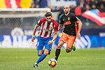 Yannick Ferreira Carrasco of Atletico de Madrid runs with the ball while Simone Zaza of Valencia CF is in pursuit during the match Atletico de Madrid vs Valencia CF, a La Liga match at the Estadio Vicente Calderon on 05 March 2017 in Madrid, Spain. Photo by Diego Gonzalez Souto / Power Sport Images
