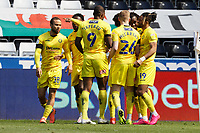 Admiral Muskwe of Wycombe Wanderers celebrates his goal with team mates during the Sky Bet Championship match Swansea City and Wycombe Wanderers at Liberty Stadium, Swansea, Wales, UK. Saturday 17 April 2021