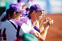 A member of the Evansville Purple Aces yells after a great hit by a teammate during a game against the Indiana State Sycamores in the 2012 Missouri Valley Conference Championship Tournament at Hammons Field on May 23, 2012 in Springfield, Missouri. (David Welker/Four Seam Images)