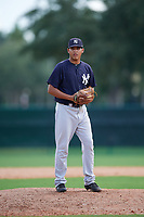 GCL Yankees West relief pitcher Havid Burgos (15) gets ready to deliver a pitch during the first game of a doubleheader against the GCL Braves on July 30, 2018 at Champion Stadium in Kissimmee, Florida.  GCL Yankees West defeated GCL Braves 7-5.  (Mike Janes/Four Seam Images)