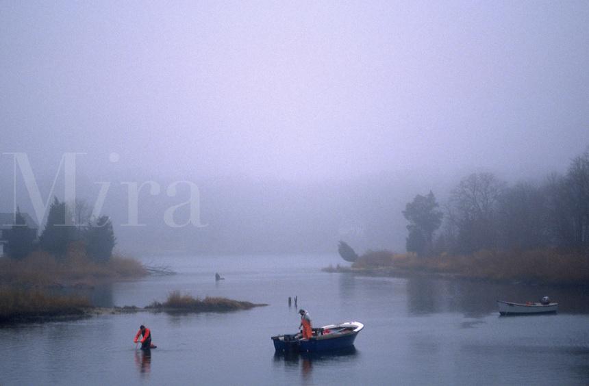 Men fishing on a misty waterway, Southampton, NY