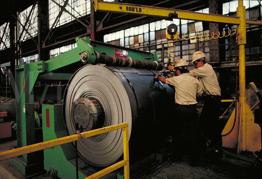 Men operating machinery at steel fabrication plant. Birmingham Alabama, Copperweld.