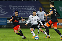 Connor Roberts of Swansea City (C) watches on as Dan Potts of Luton Town (R) moves with the ball during the Sky Bet Championship between Swansea City and Luton Town at the Liberty Stadium, Swansea, Wales, UK. Saturday 05 December 2020