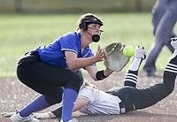 Rogers pitcher Kadence Janney (23) makes a catch, Thursday, April 29, 2021 during a softball game at Bentonville High School in Bentonville. Check out nwaonline.com/210430Daily/ for today's photo gallery. <br /> (NWA Democrat-Gazette/Charlie Kaijo)