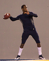 WVU quarterback Geno Smith warms up before the game. The WVU Mountaineers beat the Pitt Panthers 21-20 at Mountaineer Field in Morgantown, West Virginia on November 25, 2011.
