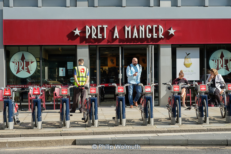 Docking station for Santander bike rental scheme in front of Pret A Manger sandwich bar, City of London.