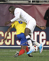 Jozy Altidore #17 of the USA MNT crashes into Falcao Garcia #9 of Colombia during an international friendly match at PPL Park, on October 12 2010 in Chester, PA. The game ended in a 0-0 tie.