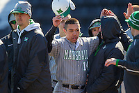 Andrew Dundon (14) of the Marshall Thundering Herd is congratulated by teammates after scoring a run against the Georgetown Hoyas at Wake Forest Baseball Park on February 15, 2014 in Winston-Salem, North Carolina.  The Thundering Herd defeated the Hoyas 5-1.  (Brian Westerholt/Four Seam Images)