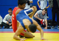 11 MAY 2014 - SHEFFIELD, GBR - Oleksandr Madyarchyk taking on a coaching role watches his competitor during a freestyle match at the British 2014 Senior Wrestling Championships in EIS in Sheffield, Great Britain (PHOTO COPYRIGHT © 2014 NIGEL FARROW, ALL RIGHTS RESERVED)