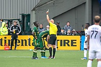 Portland, Oregon - Sunday September 22, 2019: Diego Chara is shown a yellow card during a regular season game between Portland Timbers and Minnesota United at Providence Park on September 22, 2019 in Portland, Oregon.