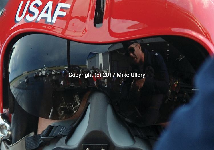 Centerville native and former Ohio State Buckeye and Green Bay Packer, A.J. Hawk gets last minute instructions from Lt. Col. Kevin Walsh, Operations Officer and pilot for the United States Air Force Thunderbirds shortly before Walsh took Hawk on the ride of his life.