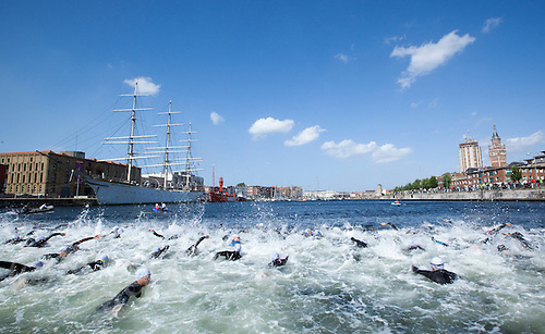 22 MAY 2011 - DUNKERQUE, FRA - Competitors make their way up the dock at the start of the Triathlon de Dunkerque .(PHOTO (C) NIGEL FARROW)
