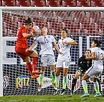 March 3, 2016 : Team USA Emily Sonnett #15, fights Team England Lucy Bronze #2, for a header on a corner kick for England, as Hope Solo #1 is intently focused, during the matchup between USA and England in the She Believes Cup at Raymond James Stadium in Tampa, Florida.  Douglas DeFelice/ESW/CSM