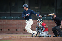 Mobile BayBears Jack Kruger (10) at bat in front of catcher Rodrigo Vigil (1) and umpire Matt Winter during a Southern League game against the Jacksonville Jumbo Shrimp on May 8, 2019 at Hank Aaron Stadium in Mobile, Alabama.  Jacksonville defeated Mobile 7-1.  (Mike Janes/Four Seam Images)