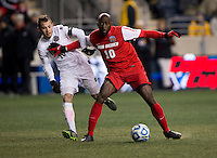 Harrison Shipp (10) of Notre Dame is held off by Michael Kafari (10) of New Mexico during the NCAA Men's College Cup semifinals at PPL Park in Chester, PA.  Notre Dame defeated New Mexico, 2-0.