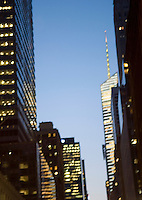 AVAILABLE FOR COMMERCIAL OR EDITORIAL LICENSING FROM GETTY IMAGES.  Please go to www.gettyimages.com and search for image # 158771974.<br /> <br /> Defocused View of Office Buildings and Illuminated Windows on 42nd Street at Dusk, Midtown Manhattan, New York City, New York State, USA