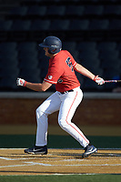 Logan Mathieu (55) of the Liberty Flames follows through on his swing against the Wake Forest Demon Deacons at David F. Couch Ballpark on April 25, 2018 in  Winston-Salem, North Carolina.  The Demon Deacons defeated the Flames 8-7.  (Brian Westerholt/Four Seam Images)