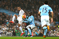 Wayne Routledge competes with Bacary Sagna during the Barclays Premier League Match between Manchester City and Swansea City played at the Etihad Stadium, Manchester on 12th December 2015