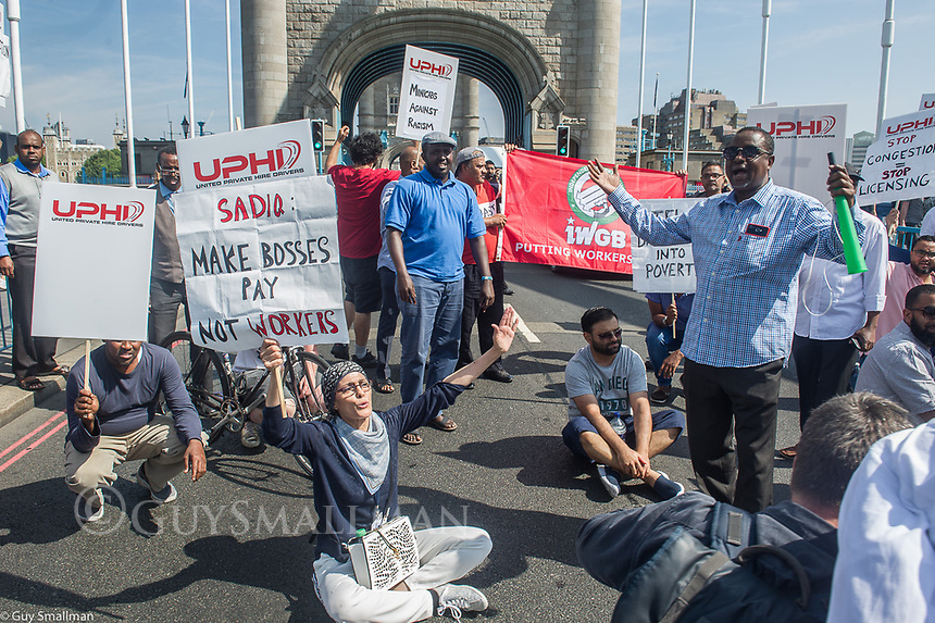 Taxi drivers and members of the IWGB Trade Union block Tower Bridge to demand that Mayor Sadiq Khan enshrines workers rights into licensing agreements for companies like Addison Lee and UBER. 25-7-18
