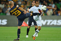 Mark BRESCIANO (23) of Australia and Mohammad AL SHALHOUB (10) of Saudi Arabia fight for the ball during the FIFA 2014 World Cup Group D Asian Qualifier match between Australia and Saudi Arabia at AAMI Park in Melbourne, Australia...This image is not for sale on this web site. Please contact Southcreek Global Media for licensing:.Toll Free: 1.800.934.5030.Canada: 701 Rossland Rd. East, Suite 315, Whitby, Ontario, Canada, L1N 9K3.USA: 10792 Baron Dr, Parma OH, USA 44130.Web: http://southcreekglobal.net/ and http://southcreekglobal.com/